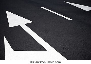 Traffic signs painted on the road.