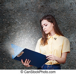 Young woman with magic folder - Young beautiful woman with...