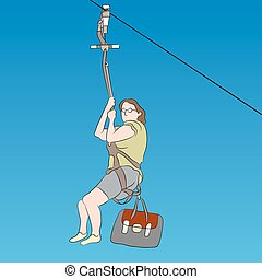 Female zip line rider - An image of a female zip line rider