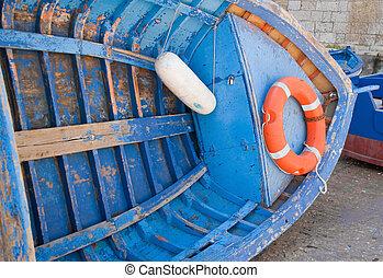 Overturned Blue Boat