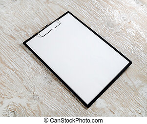 Clipboard with a blank paper