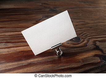 Photo of blank business card in paper clip Blank template...
