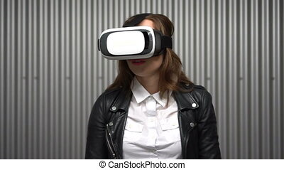 Brunette woman wearing VR glasses - Brunette sexy woman in...