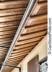 wooden carpentry - roff with wooden carpentry and gutters