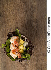 shrimp with salad and mango in coconut