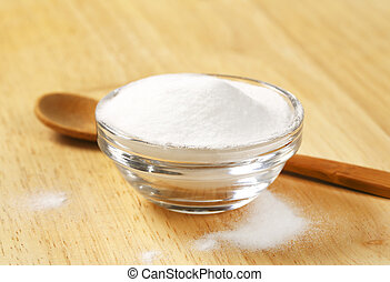 bowl of baking soda - bowl of cooking soda and wooden spoon...