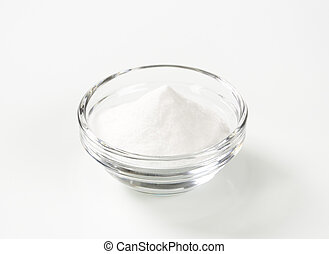 bowl of baking soda - bowl of sodium bicarbonate on white...