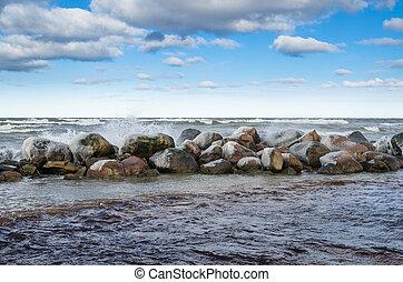 Sea waves breaking on the rocks, seascape