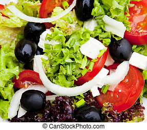 greek salad with feta, tomatoes, chives, lettuce, onion and...