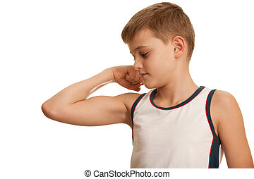Checking fitness results - A kid is checking his muscules...