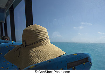 Girl tourist with beach hat on caribbean cruise