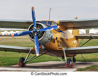Old vintage airplane - Airplane with blue propeller Old...