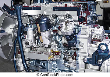 Big engine without cover and visble different parts
