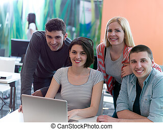 group of students study together in classroom - students...