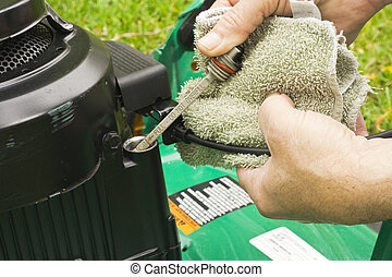 checking oil on a lawn mower - maintaining proper oil level...