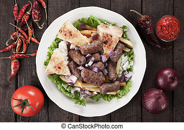 Cevapcici, bosnian minced meat kebab with somun bread, onion...