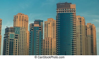 Morning view of Dubai Marina Towers in Dubai timelapse -...