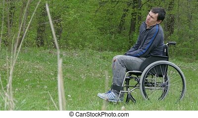 disabled man moving rides wheelchair riding walk on nature...