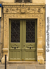 Vintage wooden door in Paris, France