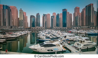 Dubai Marina at early morning hour timelapse with yachts -...