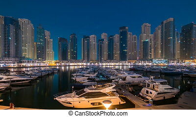 Dubai Marina at Blue hour night to day timelapse with yachts...
