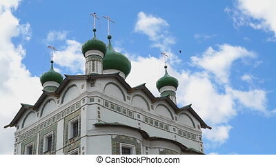 Women's Orthodox Church with green domes and crosses against...