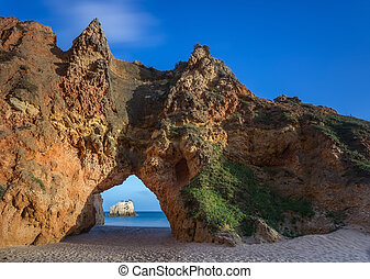 Mountain arch on the beach Portimao Portugal