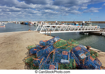 Traps for fish and shellfish on the dock The ships in the...