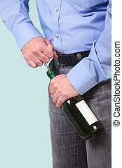 Man opening a bottle of white wine