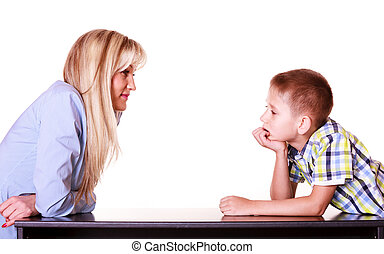 Mother and son talk and argue sit at table. - Relationships...