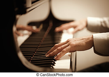 man playing piano - close up of male hands playing piano...
