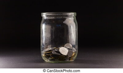 Time Lapse of Falling Coins in the Jar.