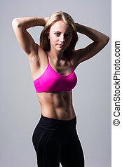 Sport girl posing in the studio.