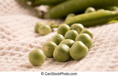 fresh green peas on a cloth