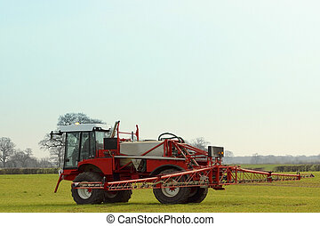 agricultural crop sprayer - red and white crop spayer in a...