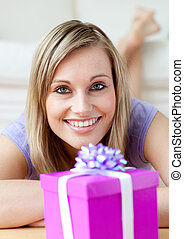Jolly woman holding a gift - Beautiful woman holding a gift...