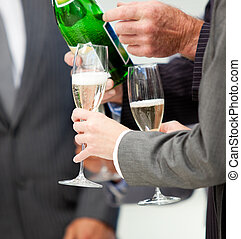 Celebration of annual profits in a company with champagne