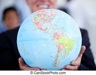Close-up of a businessman holding a terrestrial globe