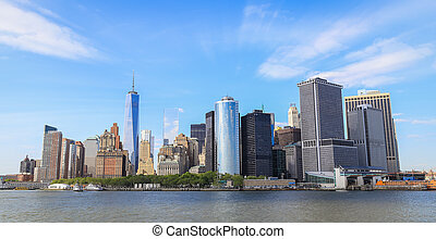 Panorama view of Manhattan, with blue sky and slightly...