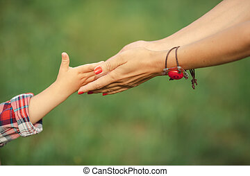 Hand of parent and child - a child hand give his parent...