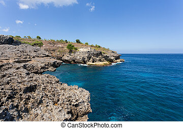 coastline at Nusa Penida island - small cove at indian ocean...