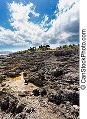 coastline at Nusa Penida island - rocks on coastline at Nusa...