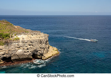 coastline at Nusa Penida island - blue indian ocea and boat...