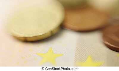 Euro coins macro rotating swiftly under the studio lighting