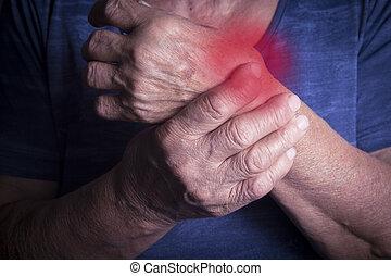 Hand Deformed From Rheumatoid Arthritis. Studio shot. Pain...