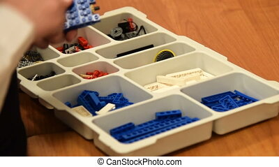 Putting robot parts in the the box - Pupil taking a robot to...