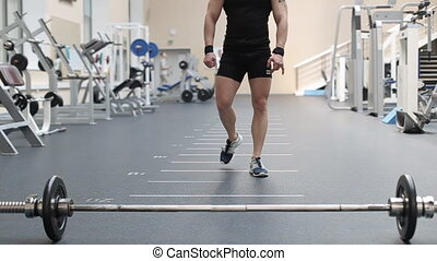 Young man doing exercises in a gym.