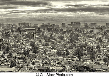 Dark clouds over the city of Addis - Aerial view of the city...