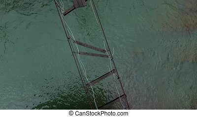 destroyed suspension bridge over river in Carpathians top...