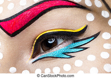 Photo of young woman with professional comic pop art make-up...